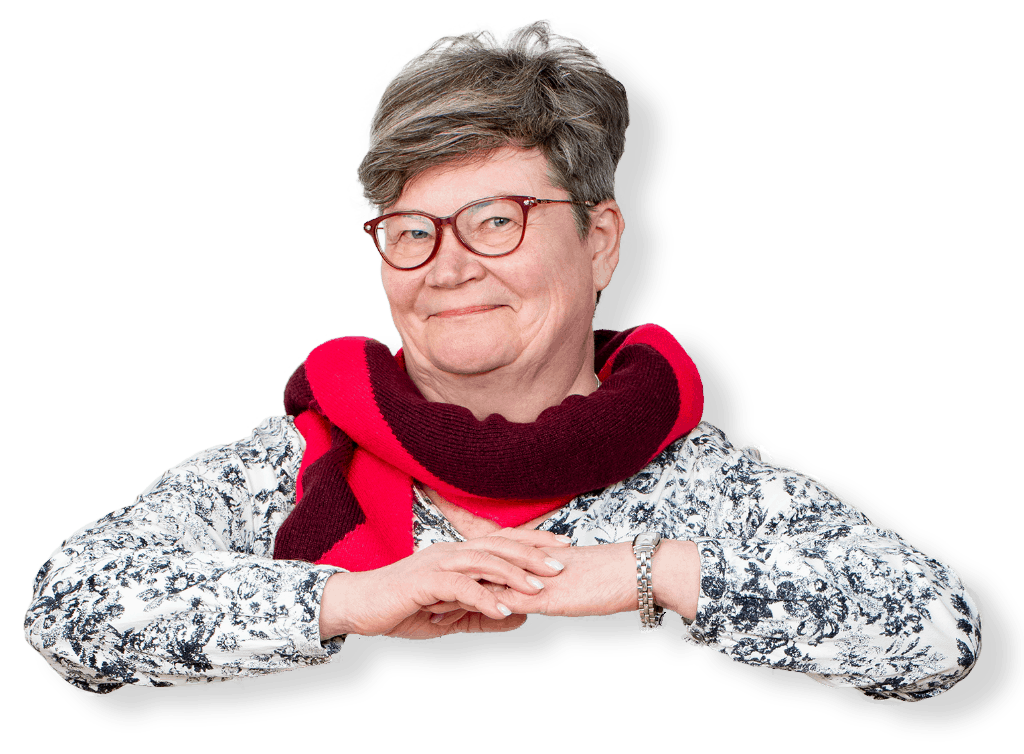 Maritta Repo, tilitoimisto Resoman yrittäjä nojaa käsivarsillaan kuvan reunaan ja katsoo suoraan kameraan.